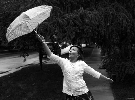 Rainy day girl with umbrella