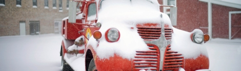 A Vintage Red Fire Truck caught in a snow storm