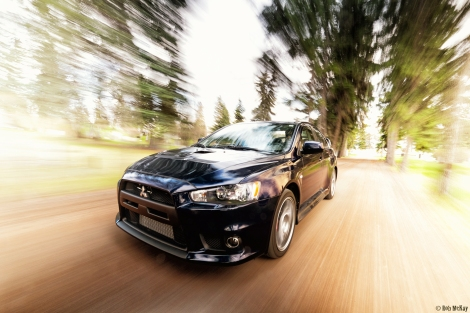 In motion - 2014 Mitsubishi EVO 10 X in cosmic blue